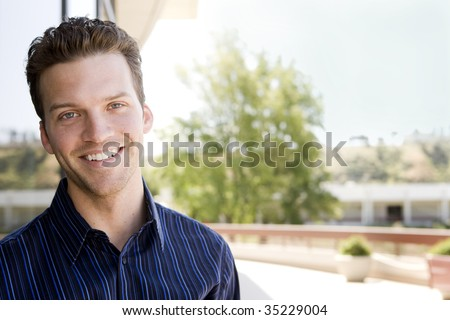 Attractive business man outside an office building - stock photo