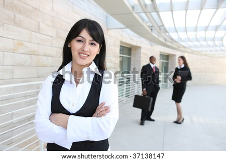 Attractive business men and women at office building
