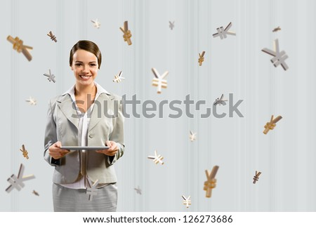 attractive business woman holding a tablet and smile, financial concept