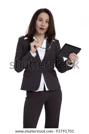 Attractive business woman holding tablet against white background.