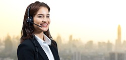 Attractive business woman in suits and headsets are smiling while working isolate on white background. Customer service assistant working in office with path. VOIP Helpdesk headset
