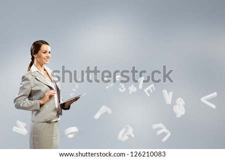 Attractive business woman is working with the tablet, Concept of digital technology