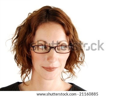 Attractive business woman looks to copy space at the left.