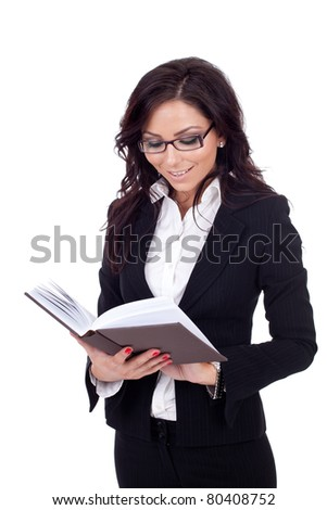attractive business woman reading a book, isolated