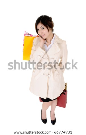 Attractive business woman shopping after working, isolated over white.