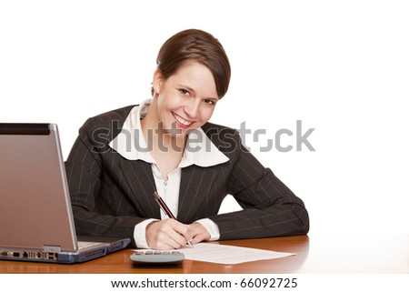 Attractive business woman sitting in office and signing contract. Isolated on white background. - stock photo