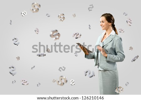 attractive business woman smiling and holding a tablet, concept of business success