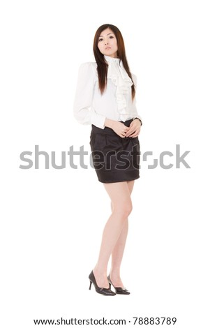 Attractive business woman standing and looking at you, full length portrait isolated on white background.