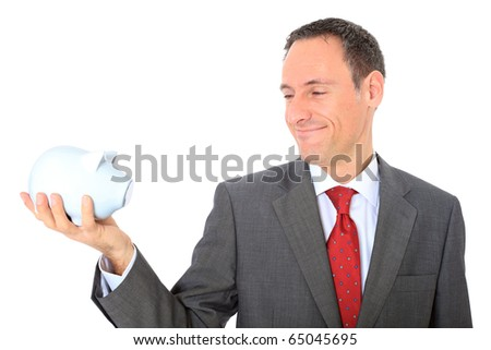 Attractive businessman holding piggy bank. All on white background.