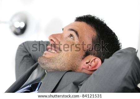 Attractive businessman is taking break from business