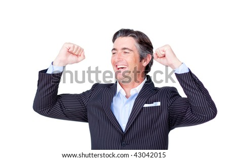 Attractive businessman punching the air celebrating a victory isolated on a white background