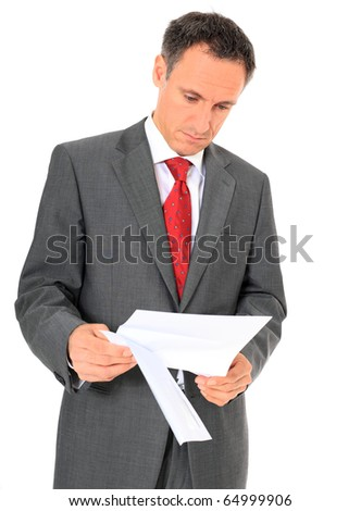Attractive businessman reading a letter. All on white background.