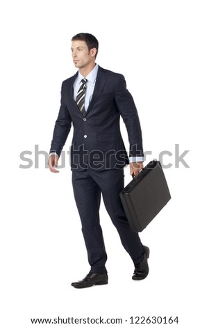 Attractive businessman walking with business attire and briefcase