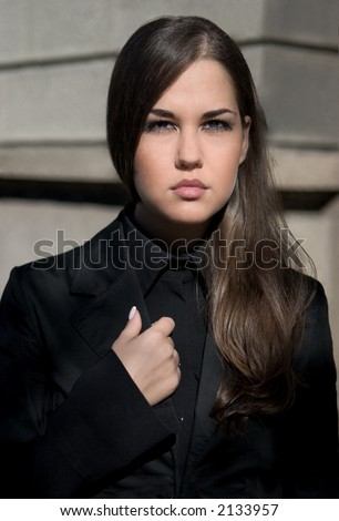 Attractive businesswoman, against an old building