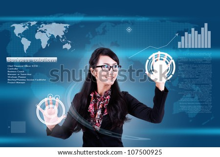 Attractive businesswoman navigating futuristic interface (outstanding business people in interiors / interfaces series)