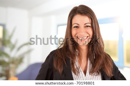 Attractive businesswoman standing in her office