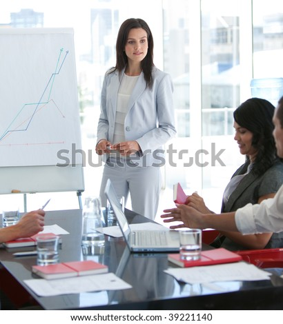 Attractive businesswoman talking to her colleague in a presentation