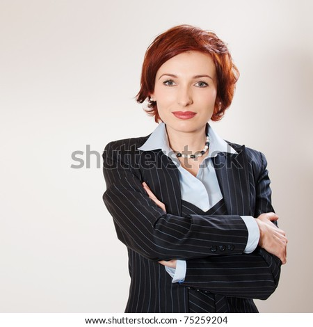 Attractive businesswoman with her arms crossed on white background