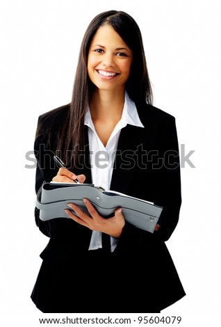 attractive businesswoman writing in her daily organizer isolated on white