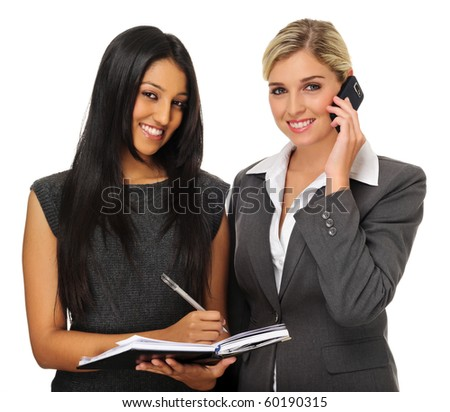 Attractive businesswomen planning their meeting with organiser and phone