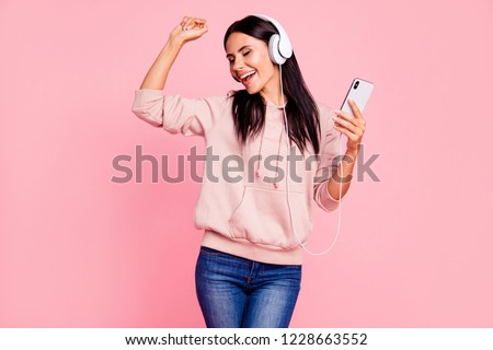 Attractive careless carefree lady with close eyes her brunet hair she raised hand up wear in trendy denim jeans urban casual outfit isolated on bright pink background hold cellular in hand