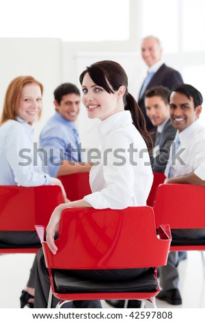 Attractive caucasian businesswoman at a conference smiling at the camera