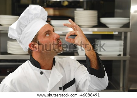 stock-photo-attractive-caucasian-chef-kissing-his-fingers-to-show-how-tasty-the-food-is-46088491.jpg