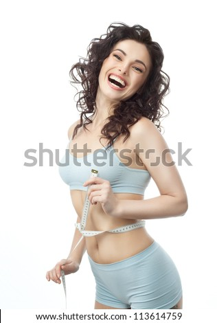 attractive caucasian woman measuring her weist isolated on white background smiling