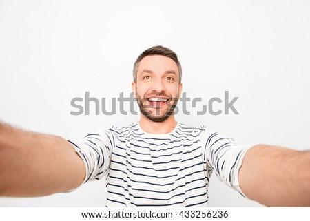 Attractive cheerful happy man making selfie Сток-фото ©