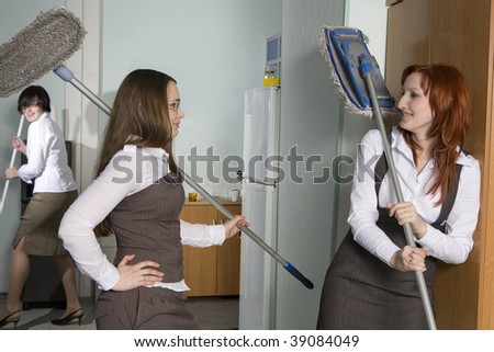 attractive clerks washing the floor in office. Boss fired cleaner.