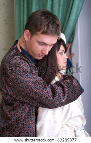 Attractive couple at home looking to the window #69285877