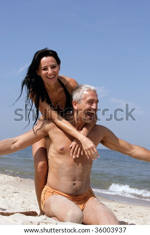 Attractive couple having fun on the beach
