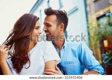 Attractive couple hugging in the city