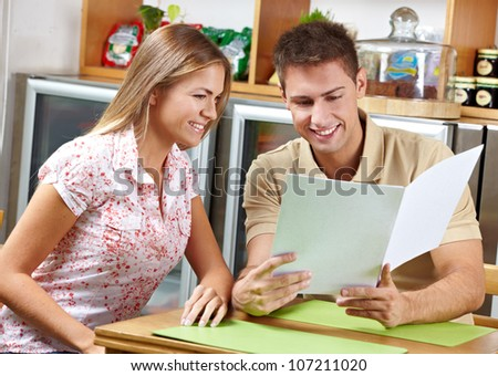 Attractive Couple looking at menu together in a restaurant