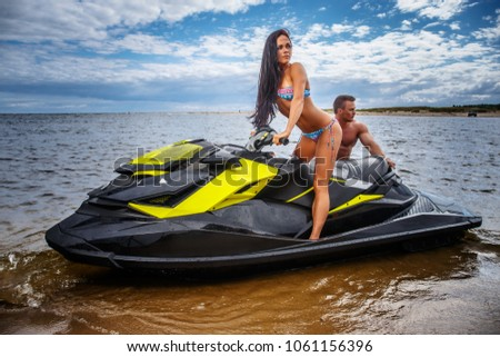 Sexy naked women on jet ski are