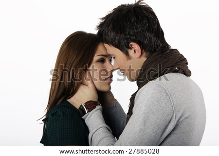 attractive couple passionately in love looking into each others eyes