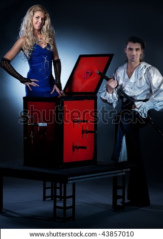 Attractive couple performing sword box illusion