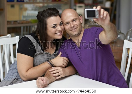 Attractive couple posing with camera