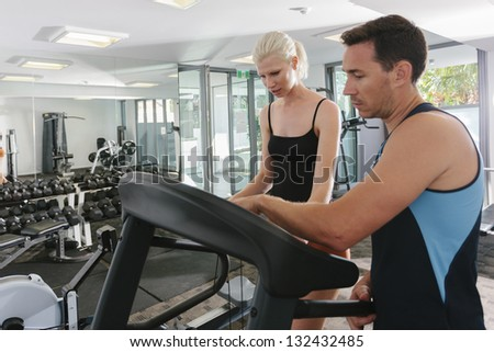 Attractive couple working out in gym
