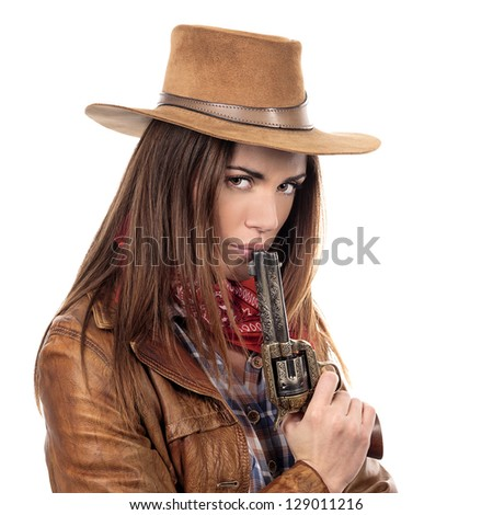 Attractive cowgirl with gun on white background