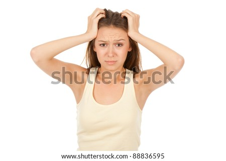 attractive depressed teenage girl hold hands on head, isolated over white background concept of sad young pretty woman, problem worried hopeless student