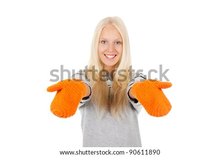 attractive excited happy smile woman looking at camera holding hands, wear winter knitted sweater and orange gloves, isolated over white background