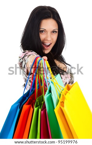 attractive excited smile teenage girl hold colorful shopping bag, looking at camera, isolated over white background