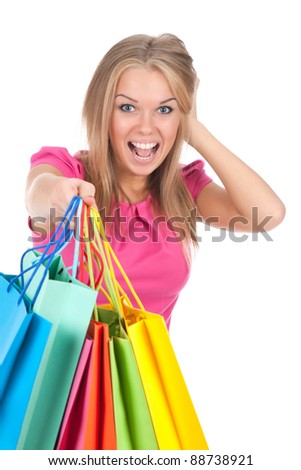 attractive excited smile teenage girl hold colorful shopping bag, looking at camera mouth open, isolated over white background