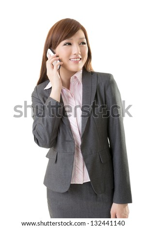Attractive executive woman talking on cellphone and smiling, half length closeup portrait on white background.