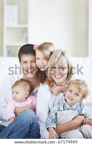 Attractive family with three children at home