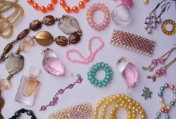 Attractive fashionable girlish ornament and jewelry with earing, bangles, pendent, and  neckless on the white background