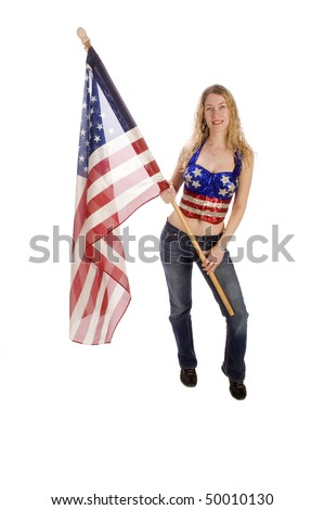 Attractive female American patriot with flag isolated over white