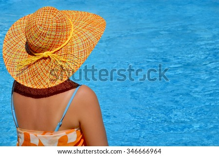Attractive female beauty enjoying her summer vacation at swimming pool  #346666964