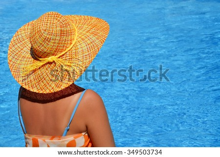 Attractive female beauty enjoying her summer vacation at swimming pool #349503734